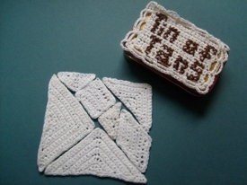the crocheted tangrams forming a square